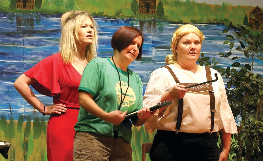 """It promises to be an intense (or in-tents, at least) performance for the Waggoner Centennial Players this year as the group kicks off its 31st year with """"Popcorn Night"""" on Wednesday, Feb. 27, with their production of """"Krazy Kamp"""" at the Waggoner Centennial Building. Above, Camp Pocahontas Director Eve Hunnicutt (Heather Millburg, center) Talks things over with one of her camp counselors, the authoritarian Hildegard Von Fishbeck (Dawn Webb, right) as camper Vivian Vandersnap (Ramie Meisner) looks on. Tickets to """"Popcorn Night"""" are available at the door and are $5 for adults and $2.50 for children"""