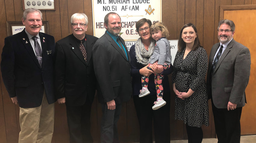 Pictured above, from the left are Master of Ceremonies Dale Marfell, Worshipful Master Charles Page, Lodge Builders Award winner Danny Robbins and Community Builder Award winners, Susie Galer with her granddaughter, Charlotte Herschelman, State Representative Avery Bourne and Judge Jim Roberts.