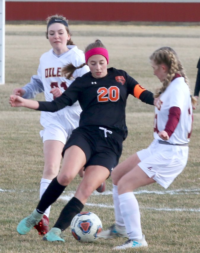 Hillsboro senior Lexi Lusk weaves through traffic during the Lady Hiltoppers' home game against East Alton-Wood River on Thursday, March 21. Lusk had one of Hillsboro's six goals as the Toppers defeated the Oilers 6-1 to improve to 3-1 on the season.