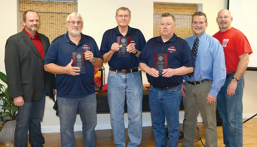 Three Hillsboro firefighters were honored for their retirement this spring at a special banquet on Friday evening, May 3, at The Event Center in Hillsboro. Pictured above, from the left are council member Danny Robbins, firefighters Tim Lipe, Terry Guthrie and Vernon Durbin, Mayor Brian Sullivan and council member Don Downs.