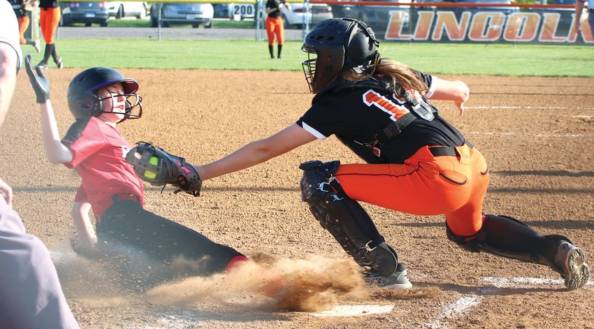 Central A&M's Morgan Malone slides just underneath the tag of Lincolnwood catcher Brittany Slightom for the first of the Raiders' four sixth inning runs on Monday, May 6. Despite a seventh inning grand slam by Slightom's sister, Lincolnwood senior Sadie Slightom, Central A&M managed to escape with a 12-5 victory over the Lady Lancers.
