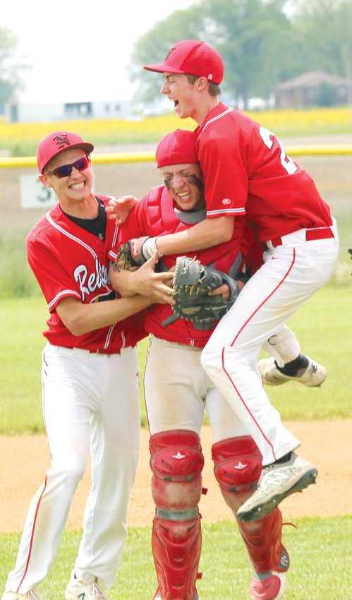 Nokomis' Nick Mascher, Ryan Janssen and Marc Grigoroff celebrate the Redskins' 3-0 victory over Cumberland in the regional championship game in Nokomis on Saturday, May 18. The title was Nokomis' eighth regional title in baseball in the last 11 years.