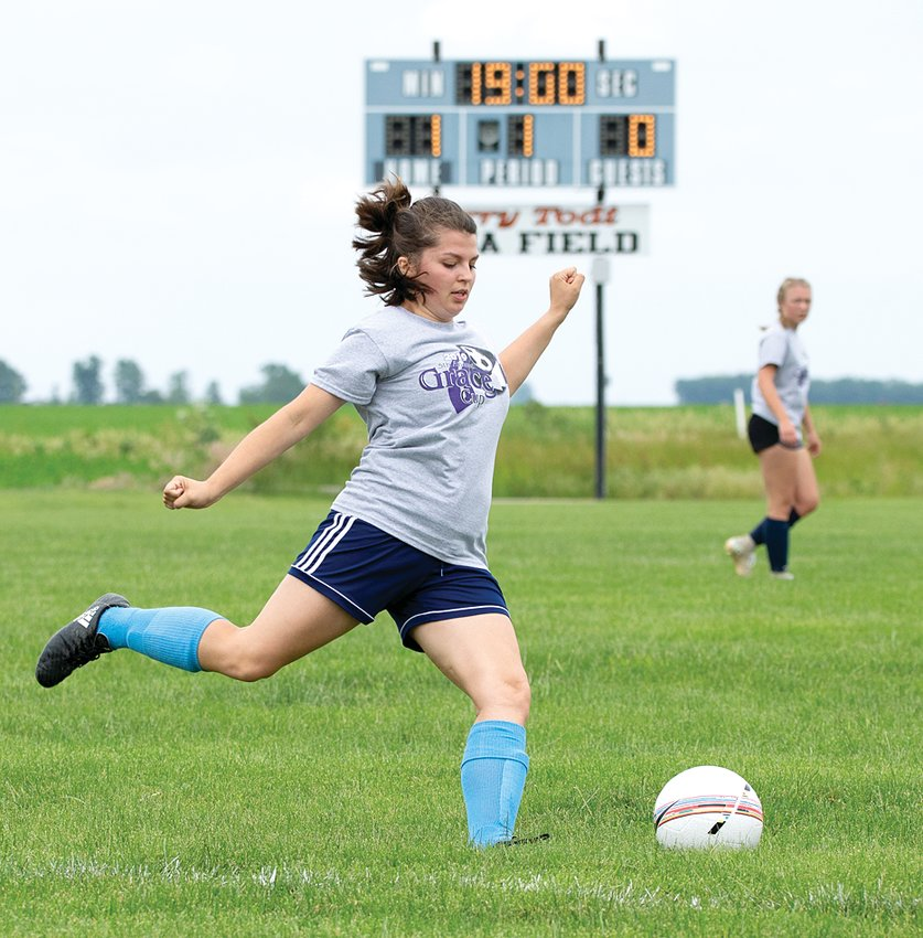 With the sign honoring the late Terry Todt in the background, Hillsboro's Blayze Horn prepares to clear a ball out of the Gray team's zone during the fifth annual Grace Cup on Saturday, June 8. Saturday's game was dedicated to Todt, who was integral in the development of the Grace Cup and soccer in the area.