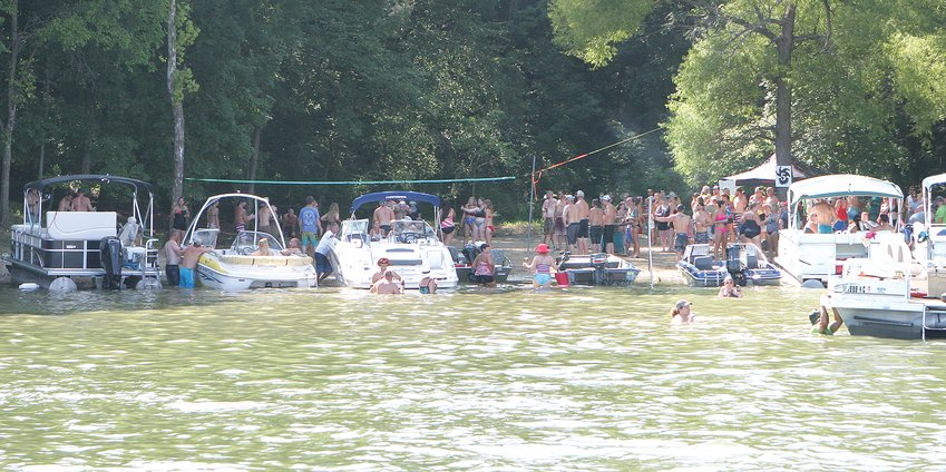 Boaters enjoy the stop sponsored by Lemo's at Adam Compton and Shane Christy's lake lot during the second annual Glenn Shoals Lake Club Aqua Run on Saturday, July 27.