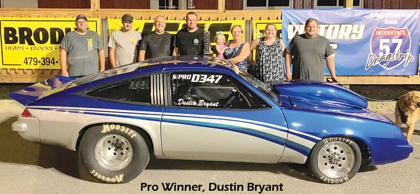 Litchfield racer Dustin Bryant had plenty of company in victory lane on Saturday, Aug. 3, at the I-57 Dragstrip in Benton, after his second win in as many weeks. From the left are Corey Wood, Scott Pinkerton, Phil Bryant, Dustin Bryant, Hadley Weller, Sharon Bryant, Sarah Weller and Randy Weller.