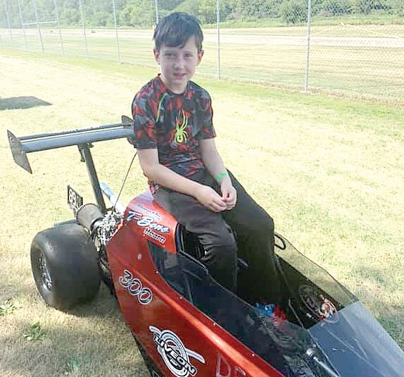 Timothy Hearn, the ten-year-old son of David and Michelle Hearn of Litchfield, waits for his run in the Midwest Junior Super Series event at Byron Dragway on Saturday, Aug. 10. Racing against older, faster competition this year, Hearn was still in third place in the 10-to-12 age group going into last weekend's race.
