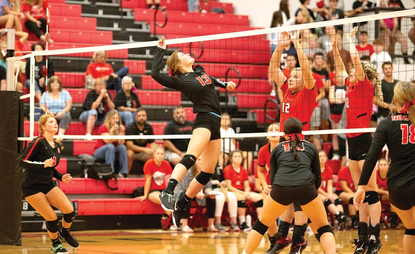 Nokomis senior Jade Jett goes up for a hit at the net during the Lady Redskins' season opener against Central A&M on Tuesday, Aug. 27. The Raiders proved to be a tough test in the opening game of the season, beating the Redskins 25-7, 25-15 in Nokomis.