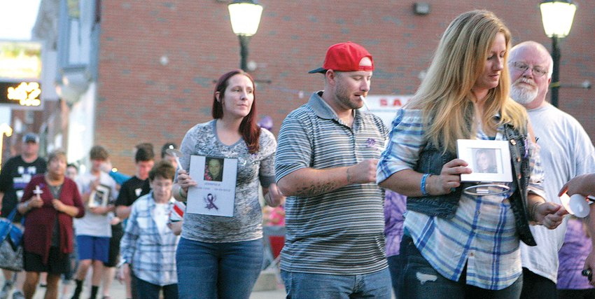 Many were clutching photos of those lost to addiction for a candlelight vigil walk around the Historic Courthouse in Hillsboro during SAAD's third annual National Overdose Awareness Day on Saturday, Aug. 31.