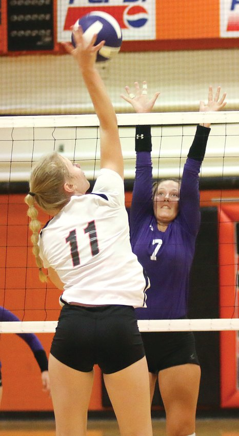 Lincolnwood's Maggie McClelland provides some resistance to Greenfield's Kersty Gibbs during the Lancers' home game on Tuesday, Sept. 3. The Lancers would hold the Tigers to just three service points in the match as they picked up a 25-10, 25-11 win, their third of the season.