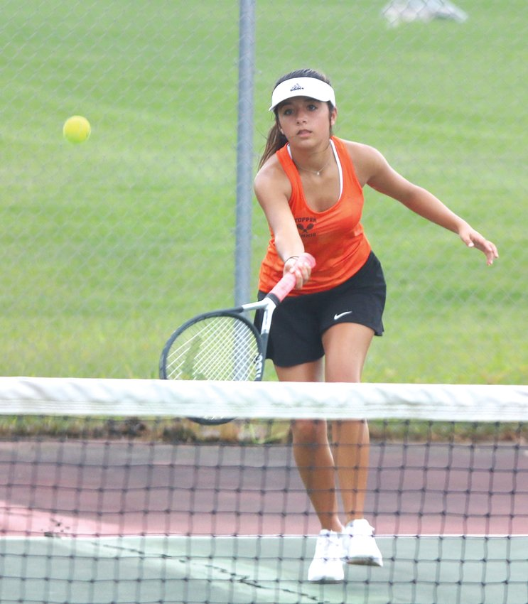 Hillsboro's Torrence Clark returns a shot during her match with Greenville's Emma Siefken on Tuesday, Sept. 3, at the Hillsboro Sports Complex. Clark would pick up a 6-0, 6-3 win over Siefken, the Toppers' only victory over the Comets on Tuesday.