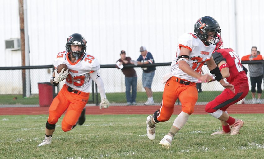 With teammate Jonah Harkins leading the way, Hillsboro senior Joey Lipe (#33) looks for running room early in the Hiltoppers' game at Staunton on Friday, Sept. 6. The Toppers would outrush the Bulldogs 181 to 158, but yielded 251 passing yards in a 40-16 loss in week two.