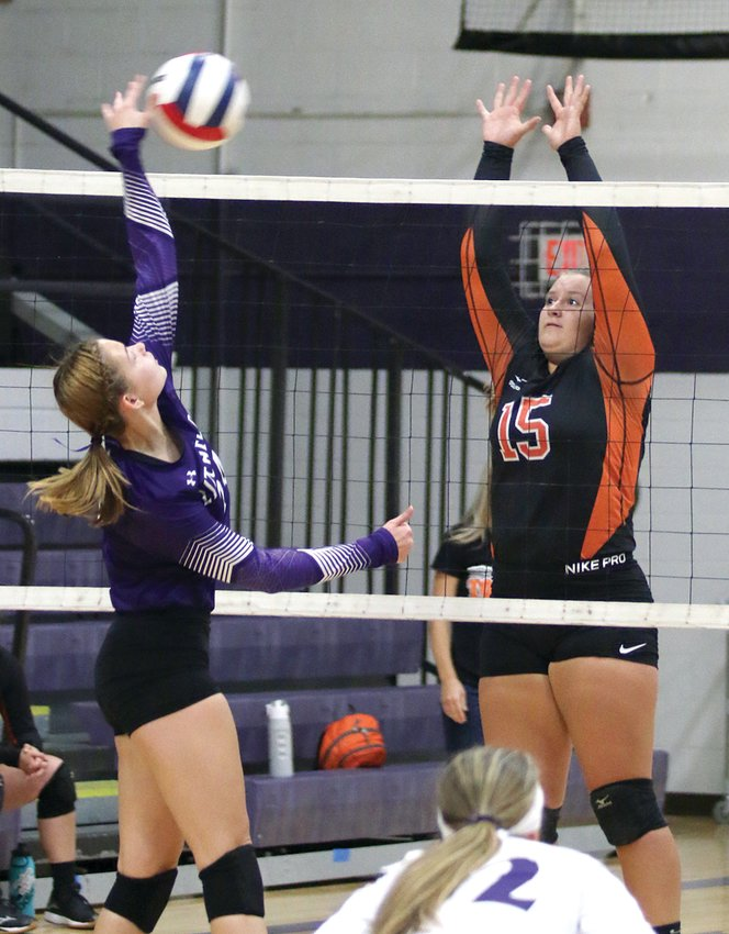 Litchfield's Carson Jackson, left, tries to get a hit over the block of Hillsboro's Chloe Beck during game one of the two county rivals' game on Thursday, Sept. 5. Litchfield would hang with the Hiltoppers early, but the visitors would come away with a pair of 25-17 victories.