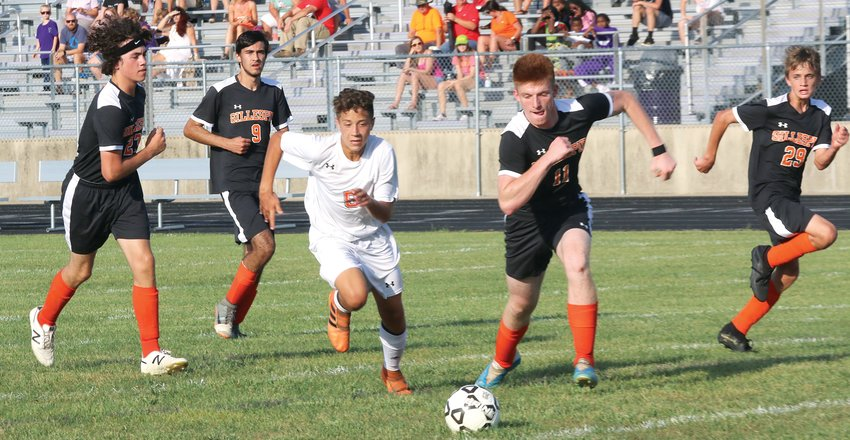 Surrounded by an army of Miners, Hillsboro's Ethan Lentz tries to track down a loose ball during the Hiltoppers' showdown with Gillespie in Litchfield on Tuesday, Sept. 17. Lentz had two goals for Hillsboro, who scored three times in the second half to net a 4-1 victory over their South Central Conference foes.