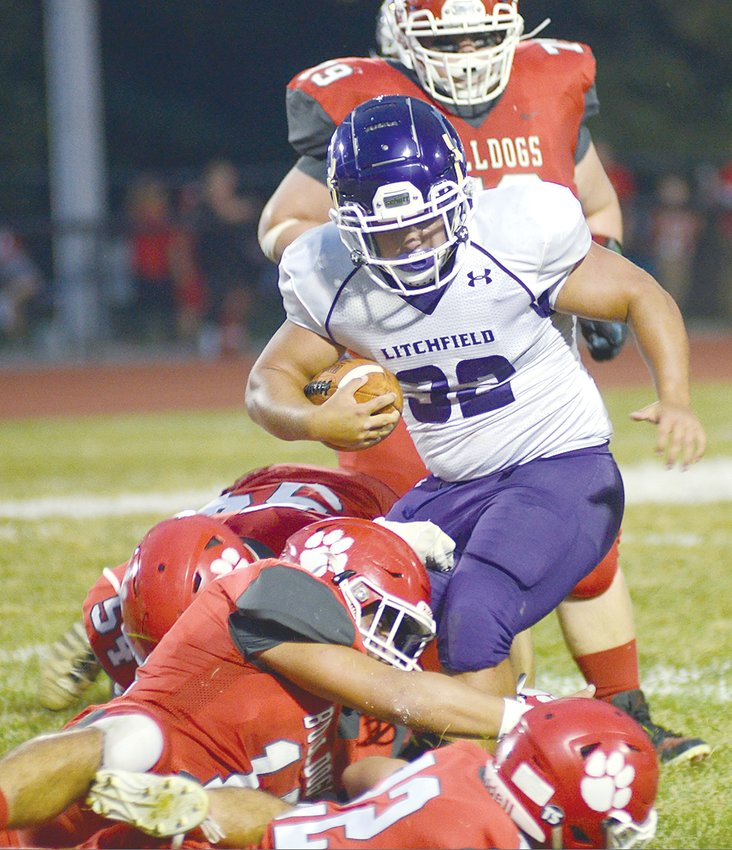 Litchfield running back Drew Hartzell wades through a sea of Staunton tacklers during the Panthers' week four match-up with the Bulldogs. Litchfield rushed for nearly 200 yards as a team, but fell to 0-4 with a 48-16 loss to the Dogs.
