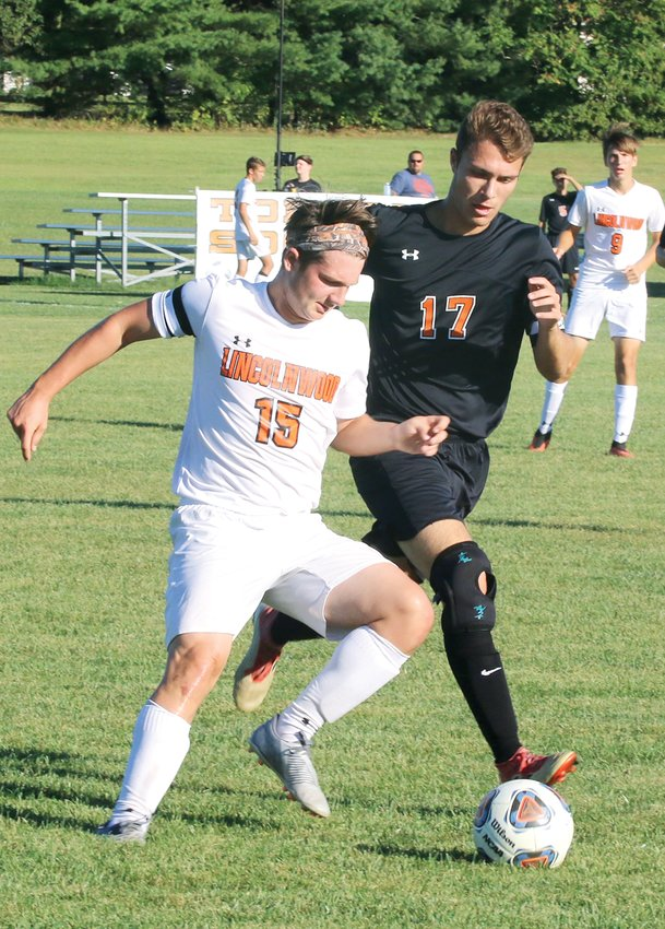 Lincolnwood's Sam Terneus (left) and Hillsboro's Dalton Greenwood (right) vie for possession during the Shoal Creek Shootout on Monday, Sept. 23, in Hillsboro. The Toppers would lead 1-0 at halftime and score two late insurance goals to pick up the win over the rival Lancers.