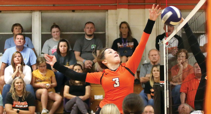 Lincolnwood junior Cassie Krager elevates to meet the ball at the net during the Lancers' home match with Gillespie on Monday, Sept. 23. Krager had seven kills in the Lancers' 25-13, 25-14 victory over the Miners, the 899th in the program's history.