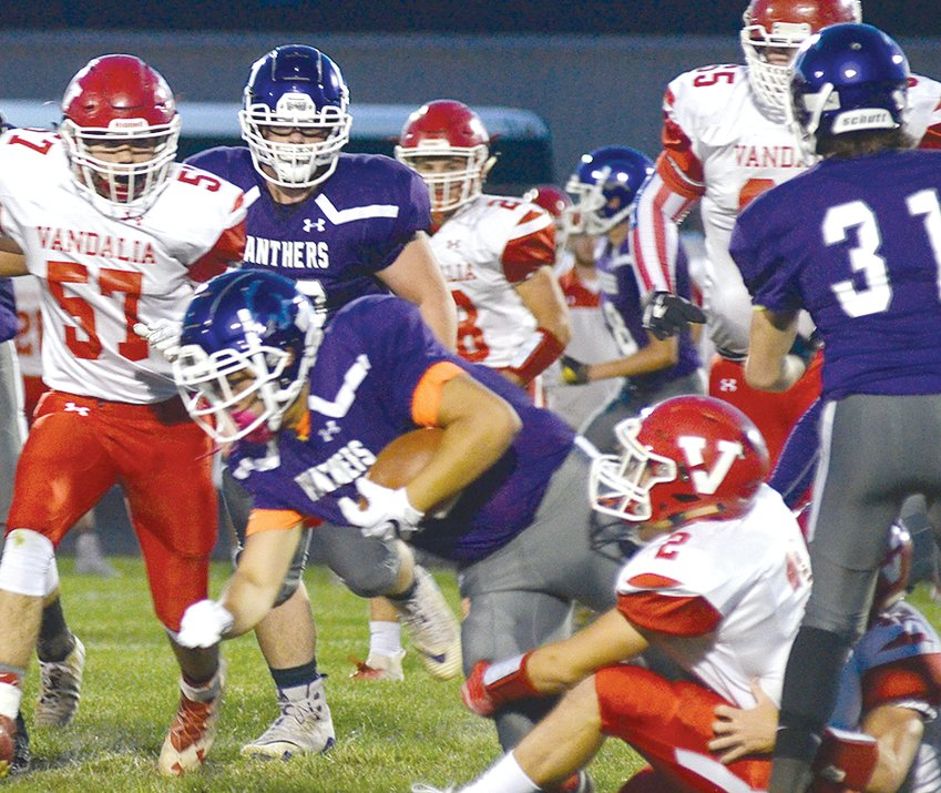 The massive frontline of the Vandalia Vandals proved to be difficult to break through on Friday, Sept. 27, as Litchfield senior John Corso found out in the first quarter. The Vandal offense was just as potent as they rolled up 51 points in the first half, en route to a 59-0 win over the Purple Panthers.