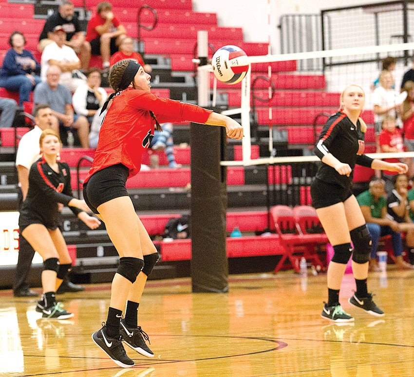 Nokomis' Delaney Keiser gets under a hit during the Redskins' home game against Madison on Thursday, Sept. 26. The Redskins would knock off the Trojans in three games to earn their second straight victory.