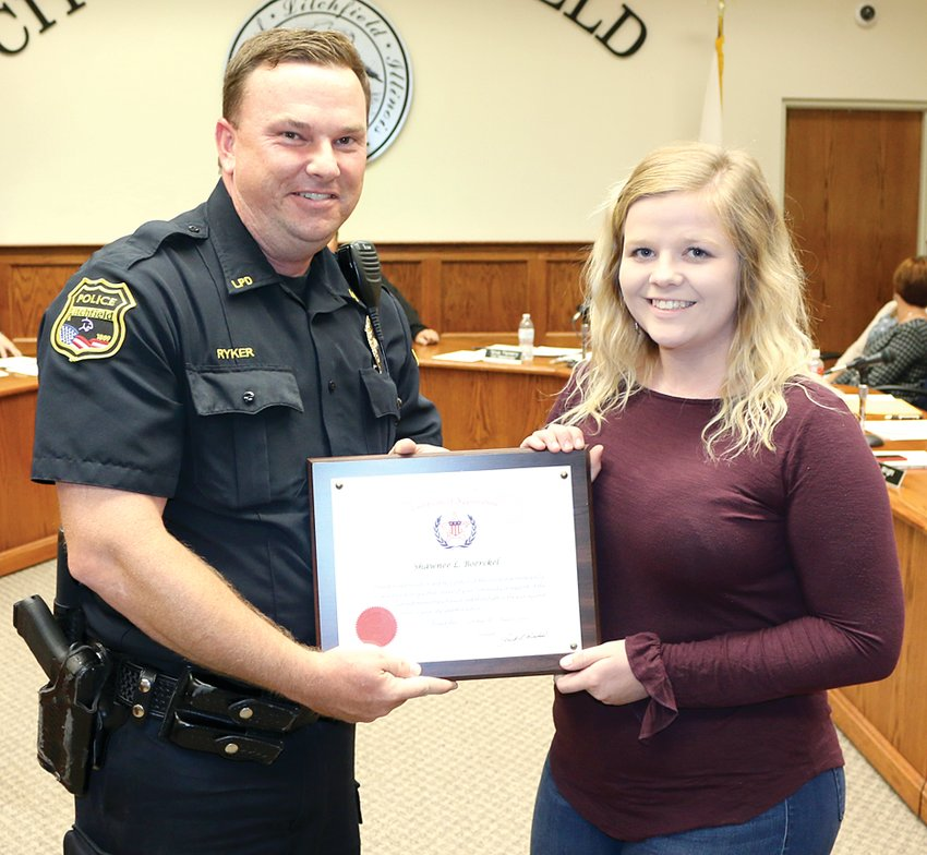 Litchfield Police Chief Kenny Ryker presented Shawnee Boerckel with the American Police Hall of Fame's Civilian Medal of Appreciation for her help in finding a missing juvenile on July 27, 2019, during the Litchfield City Council meeting on Oct. 3.