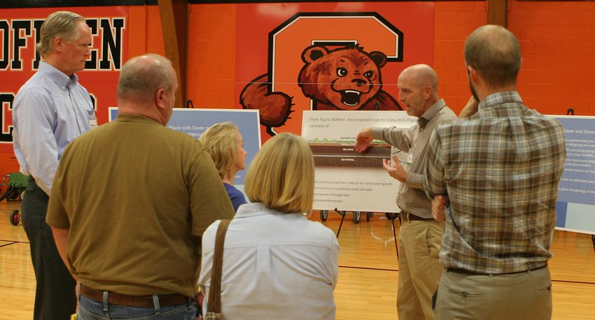 "Officials from the parent company of Coffeen Power Plant explain ""cap-in-place"" options to local officials and environmental activists during an open house at Coffeen School."