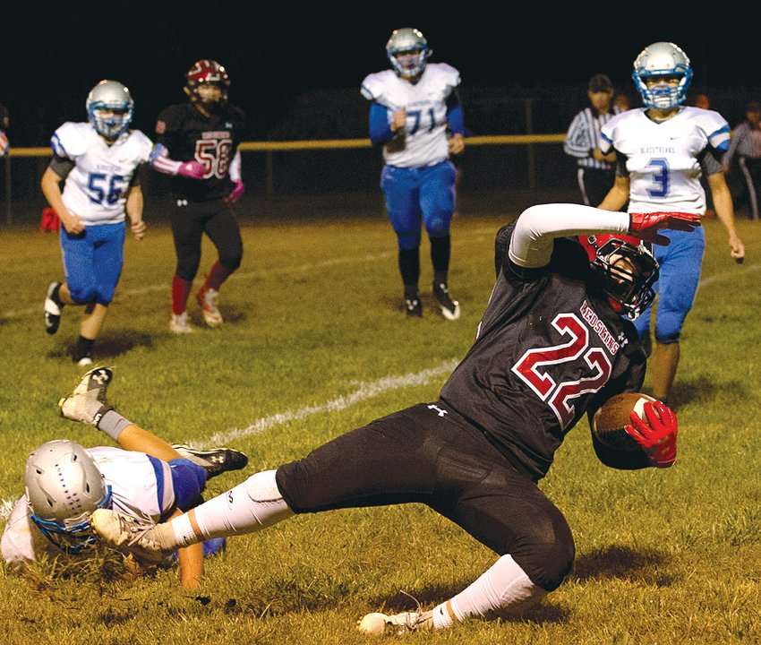 Nokomis' Cooper Bertolino stretches for every last yard after making the catch from Alex Tosetti during the Redskins' 55-0 win on Friday, Oct. 11. The victory was Nokomis' fifth on the year, putting them one win away from a guaranteed spot in the playoffs.