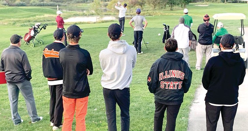 Members of the Lincolnwood High School golf team watch as senior Sam Herman tees off during the four-man playoff at the Brown County Sectional at Rolling Greens Golf Course in Mt. Sterling on Monday, Oct. 14. Herman would sink a 30-foot birdie putt to earn one of the three remaining state qualifying spots for his first trip to the state tournament on Friday, Oct. 18.
