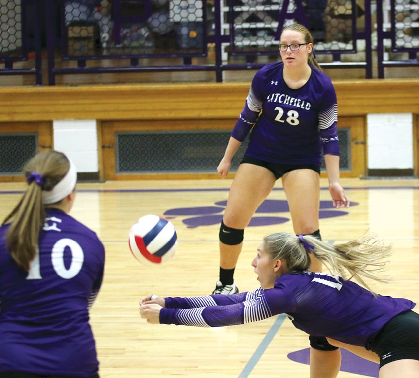 Litchfield senior Emily Senjan gets underneath a Roxana hit during senior night on Tuesday, Oct. 15, while teammates Cara Pence (28) and Devan Morgan (10) await the result. Despite a strong second set, the Panthers would fall in two to the Shells 25-13, 25-21.