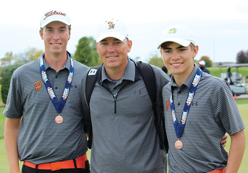For one last time, Hillsboro seniors Alex Eickhoff (left) and Alex White (right) walked away from Prairie Vista Golf Course with their coach, Jeff Eickhoff, on Saturday, Oct. 26, at the IHSA Class 1A State Golf Tournament. Eickhoff took fifth at the tournament, his fourth medal in four years, while White finished one stroke back in seventh, his second state medal.