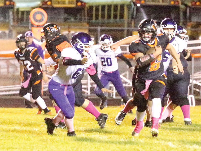 Freshman Blaze Helton (#6) eluded Litchfield's Quincy Washington (#61) and the rest of the Panthers to score a touchdown on his first varsity carry in fourth quarter action on Friday night, Oct. 18, at Sawyer Field. The touchdown was Hillsboro's ninth of the game as they defeated the Purple Panthers 60-16.