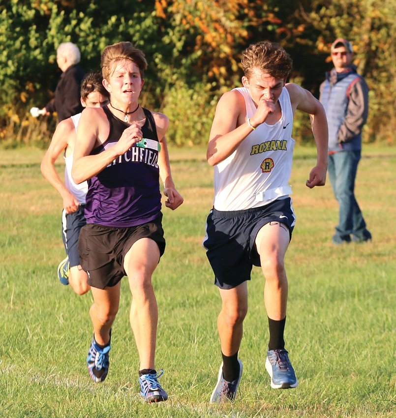 It went down to the wire for Litchfield's Brady Bishop (left) and Roxana's Dalton Baremore at the South Central Conference meet at Schneider Park in Brighton on Monday, Oct. 21. Bishop would overtake Baremore in the last few yards to finish sixth overall. He and teammate Will Carlile, who finished fourth, both earned all-conference recognition at the meet.
