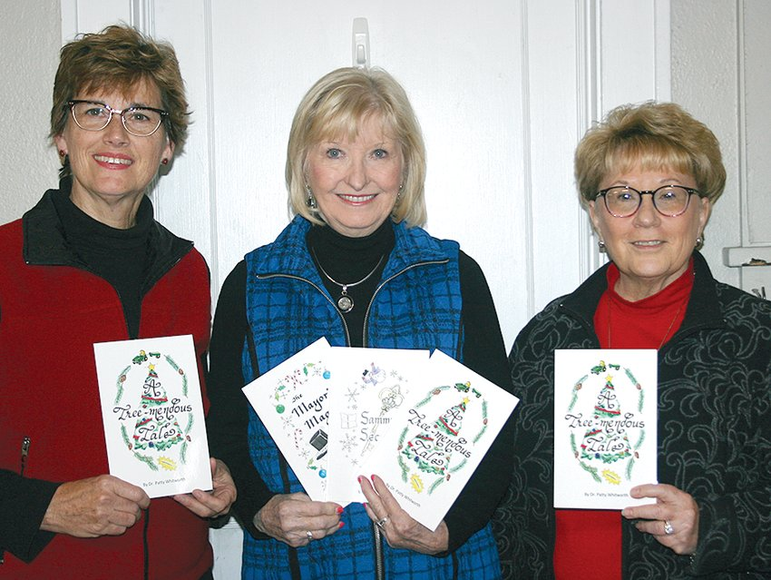 Above, from the left, Jean Mehochko, Dr. Patty Whitworth and Barb Hewitt announce the release of their third holiday book, A Tree-Mendous Tale.