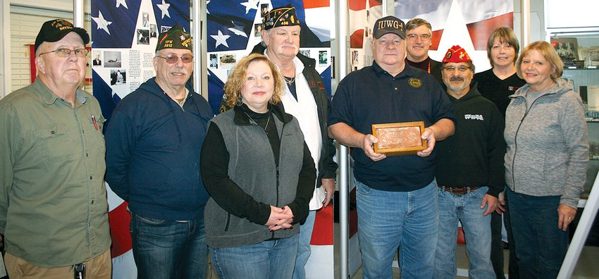 A brick from the infamous Hanoi Hilton, Vietnamese prison, was presented to Litchfield Museum and Route 66 Welcome Center on Saturday, Nov. 9. Above, from the left are VFW and American Veterans Association member Kenneth Cress, VFW #3912 Commander Ray Kellenberger, American Veterans Post #16 Commander Cindy Brune, American Legion Commander Don Bilyeu, VFW #3912 Chaplin Ron Schneider, Superintendent of the Veterans Assistance Commission Dave Strowmatt, Marine Corps League Detachment #1385 Commandant Chris Gutierrez, Secretary of Litchfield Museum Anne Jackson and President of Litchfield Museum and Route 66 Welcome Center Carol Sneed.