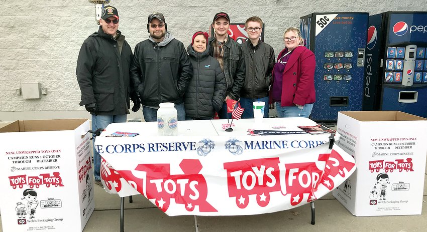 Collecting toys at Walmart in Litchfield, from the left are Marines Dave Strowmatt and Jeremy Jones, and Jeremy's family Julie, Tucker, Case and Callie.