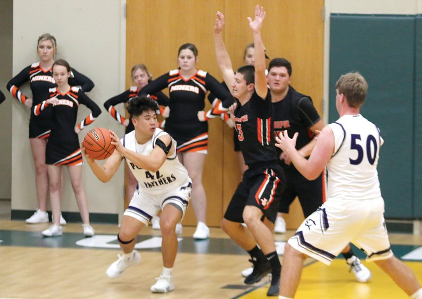 Litchfield's Anthony Boston (#50) cuts across the middle as fellow senior John Corso looks for an open man during the Panthers' opening game of the Metro-East Lutheran Turkey Tip-Off on Monday, Nov. 25.  Corso would have a team-high 11 points in the Panthers' 59-46 loss to Gillespie, which moved Litchfield to the consolation bracket.