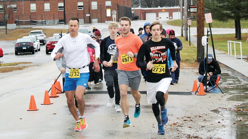 Runners and walkers endured the cold, rainy weather to participate in the annual Turkey Trot 5K Run on Saturday morning, Nov. 30. The walk started at the Hillsboro Lions Club and continued west down Fairground Ave.
