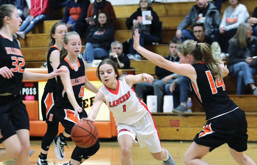 Surrounded by the Hiltopper quartet, from the left, of Adyson McCammack, Abbigail Schreiber, Sierra Compton and Paitynn Wilson, Lincolnwood freshman Jasmine Vickery looks for a way through the defense during the JV game on Monday, Dec. 2, in Raymond. The Hillsboro girls, who played the early contest since North Greene didn't have a JV squad, won 43-9.