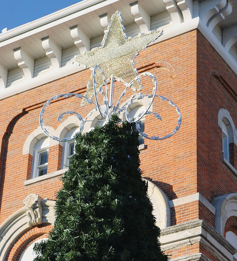 The tree is back where it belongs–ready for lighting on Saturday–and the Grinch was acquitted of wrongdoing in connection with its disappearance.  The lighting ceremony will begin at 6:30 p.m. after the parade.