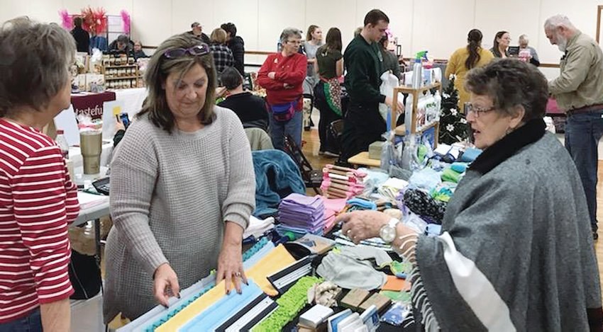 Pictured above, Cindy Moore (at left) checks out some neat items displayed by Betty Jenkins (at right).