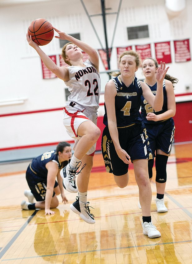 Nokomis senior Macee Eisenbarth knifes through the lane for two points during the Lady Redskins 49-26 loss to Father McGivney. Eisenbarth had 12 points and seven rebounds in the loss, both team highs, then put up 15 points and eight boards in Nokomis' 33-31 win over South County on Saturday, Dec. 14.