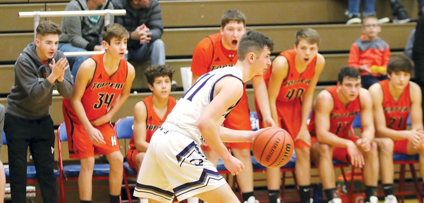 The Hillsboro bench, led by Brady Meier, Bryce Connor, Ethan Lentz, Ian Malloy and Ethan Blankenship, tries to get into the head of Litchfield's Blaine Stewart after a Topper basket in the second half of the final pool play game for both teams at the Carlinville Holiday Tournament on Saturday, Dec. 28. Stewart didn't seem to mind the extra attention as he scored 20 points in Litchfield's 69-57 win over the Hiltoppers.