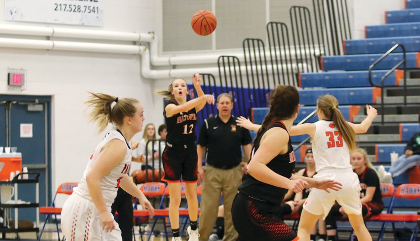 Hillsboro's Layne Rupert launches a pass down court to teammate Emily Reynolds during the Lady Toppers' pool play match-up with Pana on Thursday, Dec. 26, at the Riverton Christmas Tournament. The Panthers would jump out to an early lead en route to a 53-43 victory over Hillsboro, who would go on to finish eighth in the 16-team tournament.