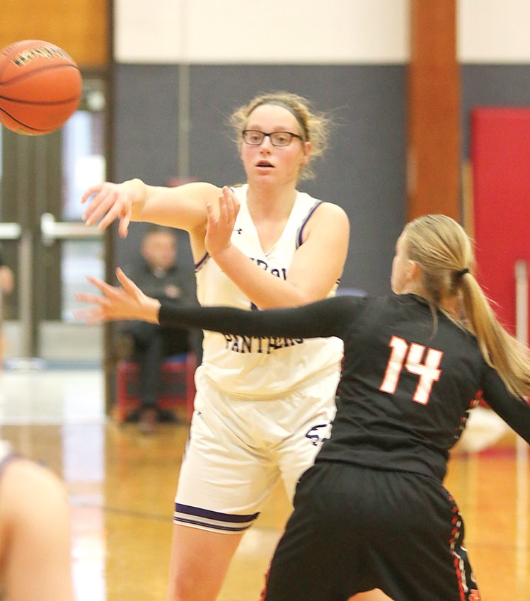 Litchfield's Cara Pence (in white) had a game-high 14 points and nearly sent the third place game at the Carlinville Holiday Tournament to overtime on Monday, Dec. 30, before Greenfield-Northwestern held on for a 42-39 victory at the Big House on West Main.