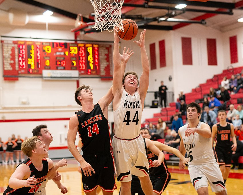As time winds down, Nokomis' Jake Johnson puts up a shot and is fouled by Sam Herman of Lincolnwood in the fourth quarter of their game on Friday, Jan. 10, in Nokomis. For just the ninth time in 70 meetings, the Lancers came up on the better end of the scoreboard against Coach Steve Kimbro's Redskins as they defeated Nokomis 50-44 in Nokomis.
