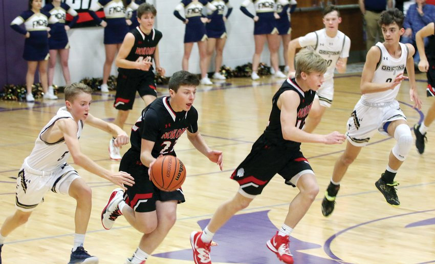 Father McGivney guard Jacob Huber (#5) tries in vain to recover the ball after Ty Knodle's fourth quarter swipe that led to two points on a Nokomis fast break on Monday, Jan. 20, at the 2020 Rick McGraw Memorial Invite in Litchfield. Knodle was one of seven Nokomis players to score in the Redskins' 58-24 win over the Griffins, who finished 0-2 in pool play. The Skins will play at Panther Gym on Tuesday, Jan. 21, at 7:30 p.m. as they close out pool play against Gateway Legacy Christian Academy.