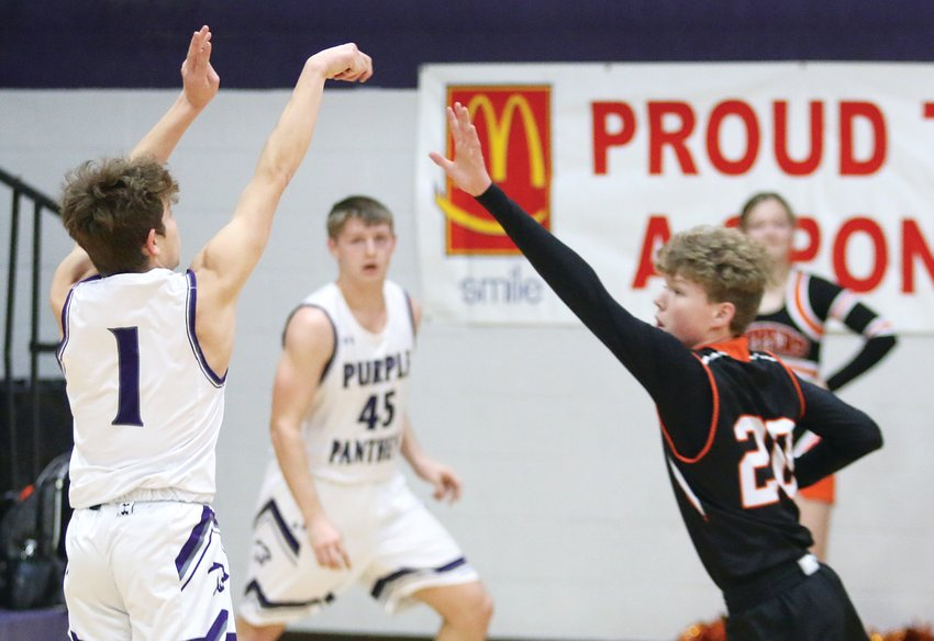 Two days after falling to Taylorville 94-76, the Hillsboro boys basketball team found themselves in another high scoring affair at the 2020 Rick McGraw Memorial Invitational as they defeated Litchfield 82-74 on Monday, Jan. 20. The Toppers, who rallied back from a five-point deficit after three quarters, were led by Drake Vogel (right), who hit seven threes for 21 of his 25 points. Litchfield got 18 points from senior Brady Bishop, who made his return to the line-up after missing the 16 of the Panthers' first 17 games.