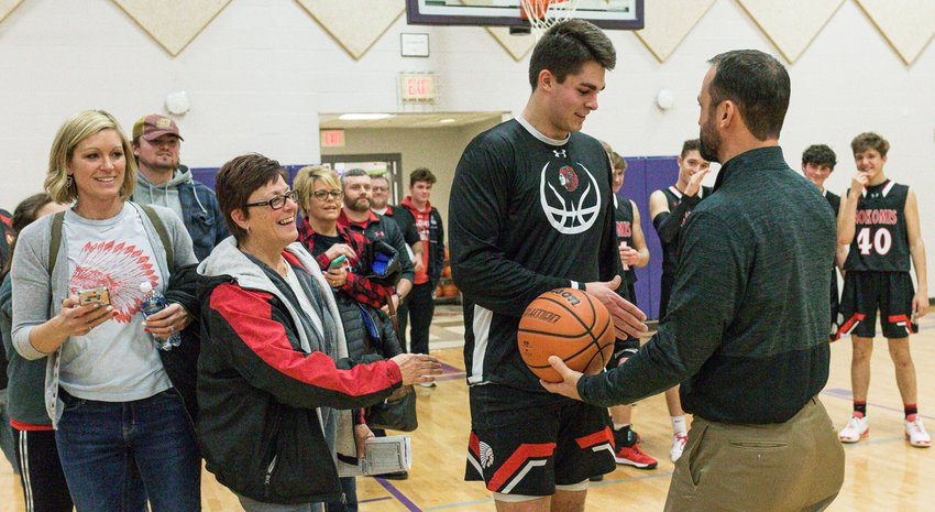 Nokomis grad Mike Havera was on hand after Nokomis' win over Gateway Legacy Christian Academy on  Tuesday, Jan. 21, to present Carter Sabol with a handshake and the game ball after Sabol broke Havera's school scoring record of 1,859 points. Havera, an assistant coach for Taylorville, was able to break away from the Tornadoes' game down the hall in Litchfield in order to see the historic moment happen in the third quarter of the Redskins' victory.