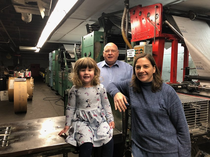 It's been 75 years since Delford Galer moved his family from Wisconsin to Hillsboro, IL to work at The Hillsboro Journal. His family continues to operate the newspaper today. From the left are his great-great-granddaughter, Charlotte Herschelman, his grandson and owner of The Journal-News John Galer, and his great-granddaughter, Mary (Galer) Herschelman, who is the paper's editor.