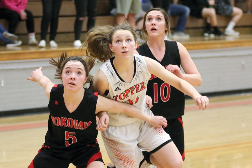Nokomis' Natalie Engelman (#5) and Mia Fesser (#10) and Hillsboro's Alex Frailey work to get position for a rebound in the first half of the county showdown in Hillsboro on Monday, Feb. 3. Hillsboro would lead 33-12 at the halfway point of the contest, en route to their fourth straight win by a 55-32 final score.