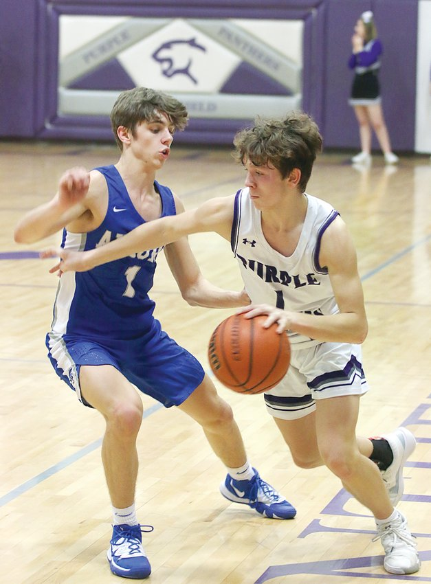 Litchfield senior Brady Bishop tries to work his way around Auburn defender Payton Krager during the Purple Panthers' game at home on Tuesday, Feb. 4. Bishop would lead Litchfield with 12 points, while Krager had a team-best 18 in Auburn's 69-51 victory at Simmons Gym.