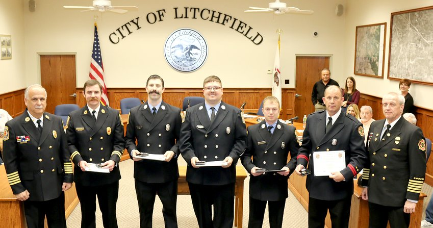 Four Litchfield firefighters and one Staunton firefighter were honored prior to the start of the Litchfield City Council meeting on Thursday, Feb. 6, for their work during the emergency flooding in southern Illinois in July of last year. From the left are Litchfield Fire Chief Joe Holomy, Captain Curt Clover, Litchfield firefighters Mathew Boston, Chad Dooley and David Rogers, Staunton firefighter Ron Maedge and Staunton Fire Chief Rick Haase.